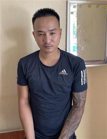 Trong ảnh: Đối tượng Nguyễn Văn Thiết tại cơ quan công an. Ảnh: TTXVN phát